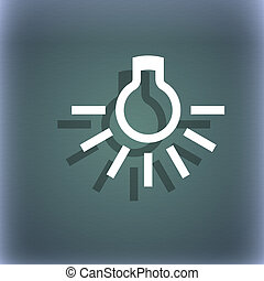 light bulb icon symbol on the blue-green abstract background...