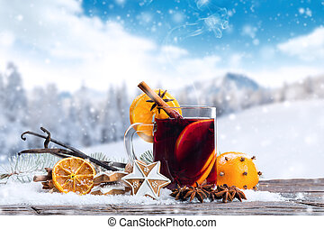 Hot red wine drink on wooden table