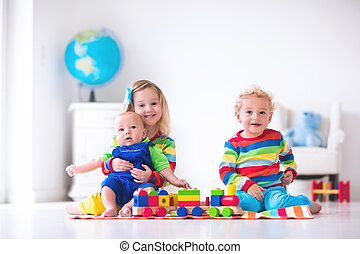 Kids playing with wooden toy train - Children playing with...