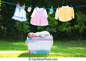 Baby boy on a pile of towels outdoors - Newborn baby on a...