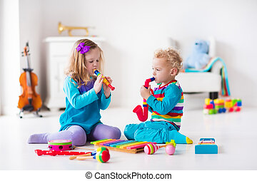 Boy and girl playing flute - Children with music...