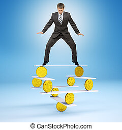 Businessman standing on balance with coins and looking down