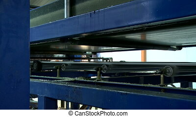 Process gluing of chipboard at factory - Modern machine for...