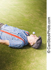 Golf Tee Off - Wacky Concept Of A Golfing Man Laying Down On...
