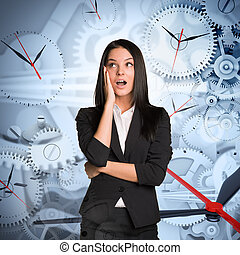 Surprised businesslady with clocks - Surprised businesslady...