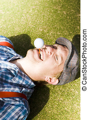 Insane Sport Nut Crazy About Golf Lying Down On A Golf...