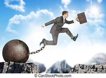 Image of young businessman jumping over gap - Image of young...