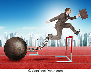 Businessman jumping over barrier - Businessman with suitcase...