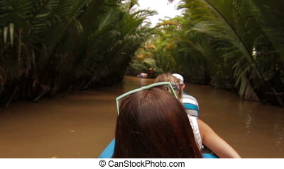 Tropical forest river boat trip on Mekong Vietnam - Tropical...