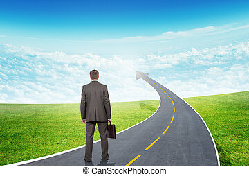 Man standing on freeway road going up as arrow - Businessman...
