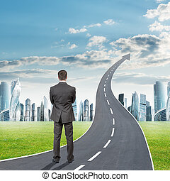 Man standing on grey freeway going up as arrow - Businessman...