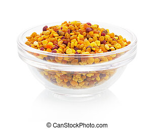 Bee pollen in the bowl on white background