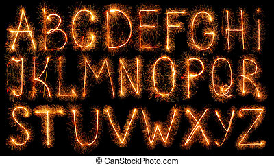 Alphabet made of sparklers isolated on black background