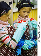 Little cleaning lady - Little girl cleaning an old dirty...