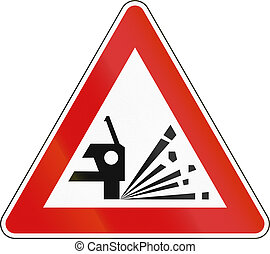 Slovenian road warning sign - Loose chippings.