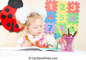Cute child girl drawing