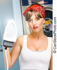 Happy Young Pretty Woman Ironing