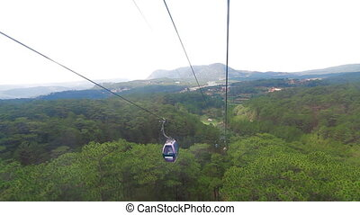 Cableway in Da lat Vietnam - POV. View from window cable...