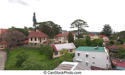 Horizontal pan of house roofs in Da Lat Vietnam - Horizontal...