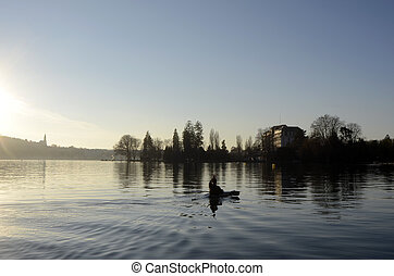 Annecy lake landscape and kayaker in France - Kayaker and...