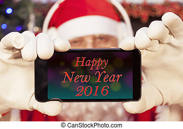 santa claus showing greetings happy new year on a smart...
