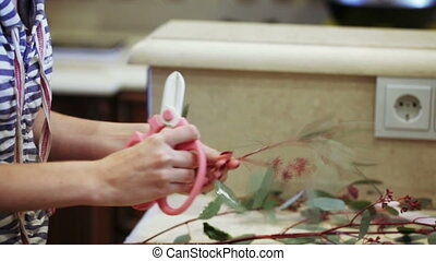 Create decorative bouquet - Woman creates composition of...