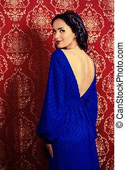 evening dress - Portrait of a beautiful brunette woman in...