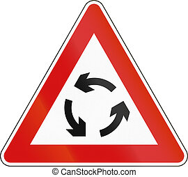 Slovenian road warning sign - Traffic circle.