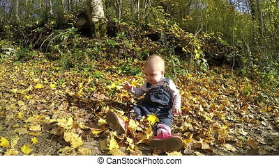 little girl playing in the autumn park. Full HD video