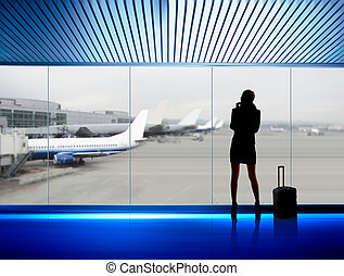 businesswoman in airport - silhouette of businesswoman which...
