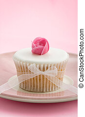 Rosebud cupcake - Cupcake decorated with a pink wafer rose