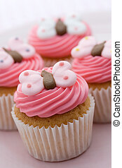 Butterfly cupcakes - Cupcakes decorated with pink frosting...