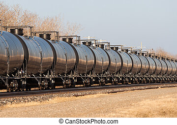 Line of Tank Cars Into Distance - Railway Tank Cars in a...