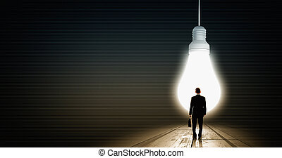 Find great bright idea - Back view of businessman looking at...