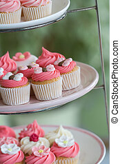 Afternoon tea - Selection of cupcakes displayed on a cake...