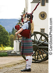 Scottish bagpiper in the grounds of Blair Castle - Bagpipe...