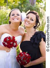 Bride With Maid-Of-Honor - A Bride Wearing A Wedding Dress...