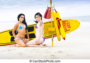 Sexy Lifesaver Beach Patrol Concept With Two Glamour Beach...