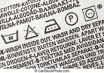 Laundry advice clothing tag - Close up view on an isolated...