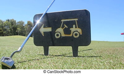 Golf 1 - A golf iron is picked up as a player walks by a...