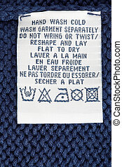 Washing label tag - Close up view of a laundry advice...