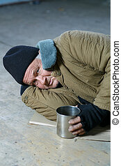 Homeless man lying on the floor - Beggars life Depressed...