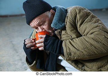 Homeless man hungrily drinking water - Thirsty beggar Upset...
