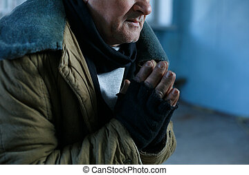 Old homeless man is praying for help - Desperate man...