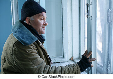 Homeless man is looking out of the window - Unhappy man...