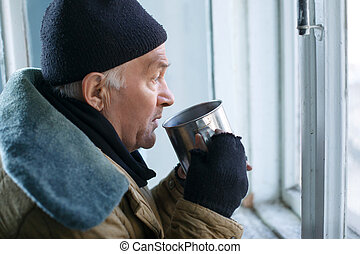 Homeless man holding his iron cup - Beggar and cup Sorrowed...