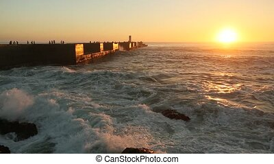 Atlantic ocean surf on the pier during a stunning sunset.