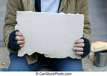 Homeless man holding a cardboard sign - Asking for help Sad...