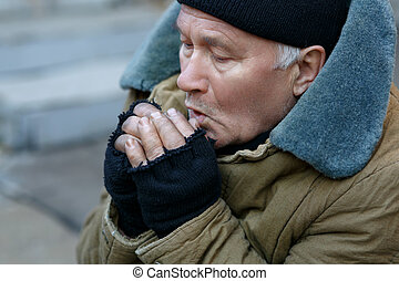 Homeless man is feeling cold - Freezing outside Senior-aged...