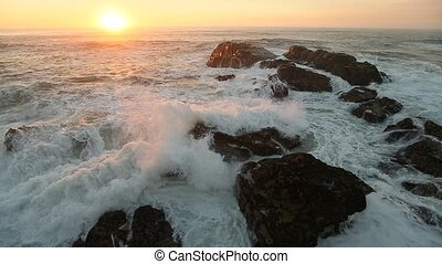 Surf on the coastal rocks leading into the ocean during a...